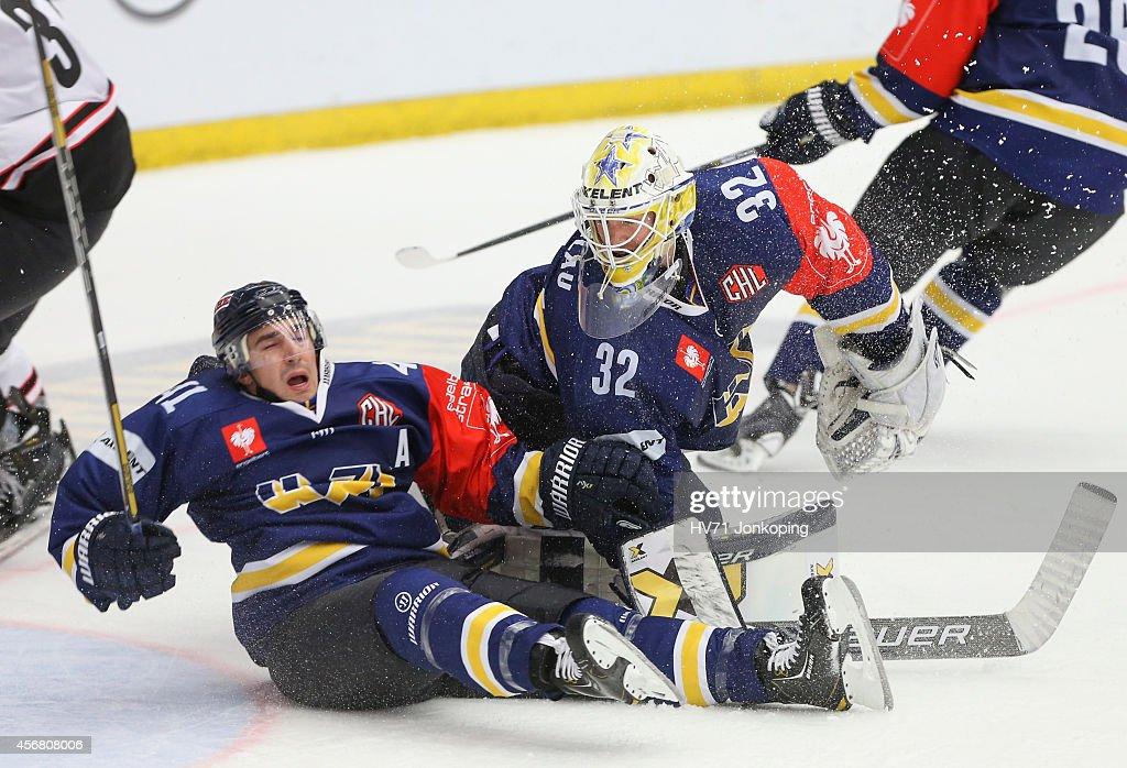 #41 of HV71 collides with Gustaf Wesslau #32 Goaltender of HV71 ...