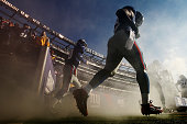 Chris Canty of the New York Giants runs onto the field against the Washington Redskins during their game at MetLife Stadium on December 18 2011 in...