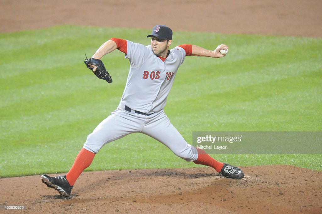 Chris Capuano #55 of the Boston Red Sox pitches during a baseball game against the Baltimore Orioles on June 11, 2014 at Oriole Park at Camden Yards in Baltimore, Maryland. The Orioles won 6-0.
