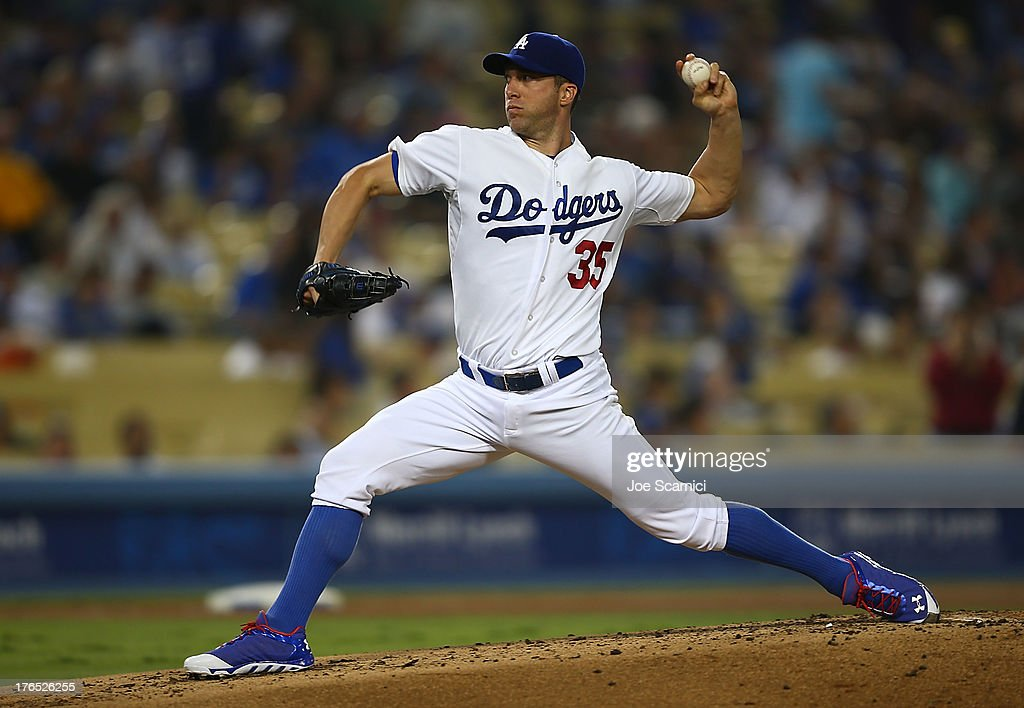 <a gi-track='captionPersonalityLinkClicked' href=/galleries/search?phrase=Chris+Capuano&family=editorial&specificpeople=228059 ng-click='$event.stopPropagation()'>Chris Capuano</a> #35 of the Los Angeles Dodgers pitches against the New York Mets at Dodger Stadium on August 14, 2013 in Los Angeles, California.