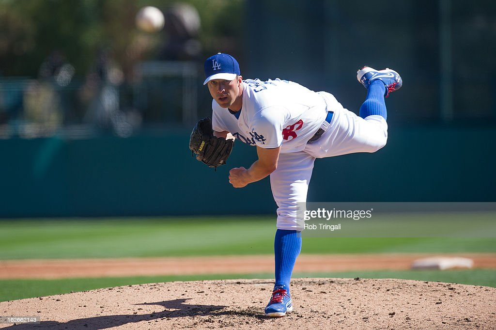 <a gi-track='captionPersonalityLinkClicked' href=/galleries/search?phrase=Chris+Capuano&family=editorial&specificpeople=228059 ng-click='$event.stopPropagation()'>Chris Capuano</a> #35 of the Los Angeles Dodgers pitches during a spring training game against the Chicago Cubs at Camelback Ranch on February 25, 2013 in Glendale, Arizona.