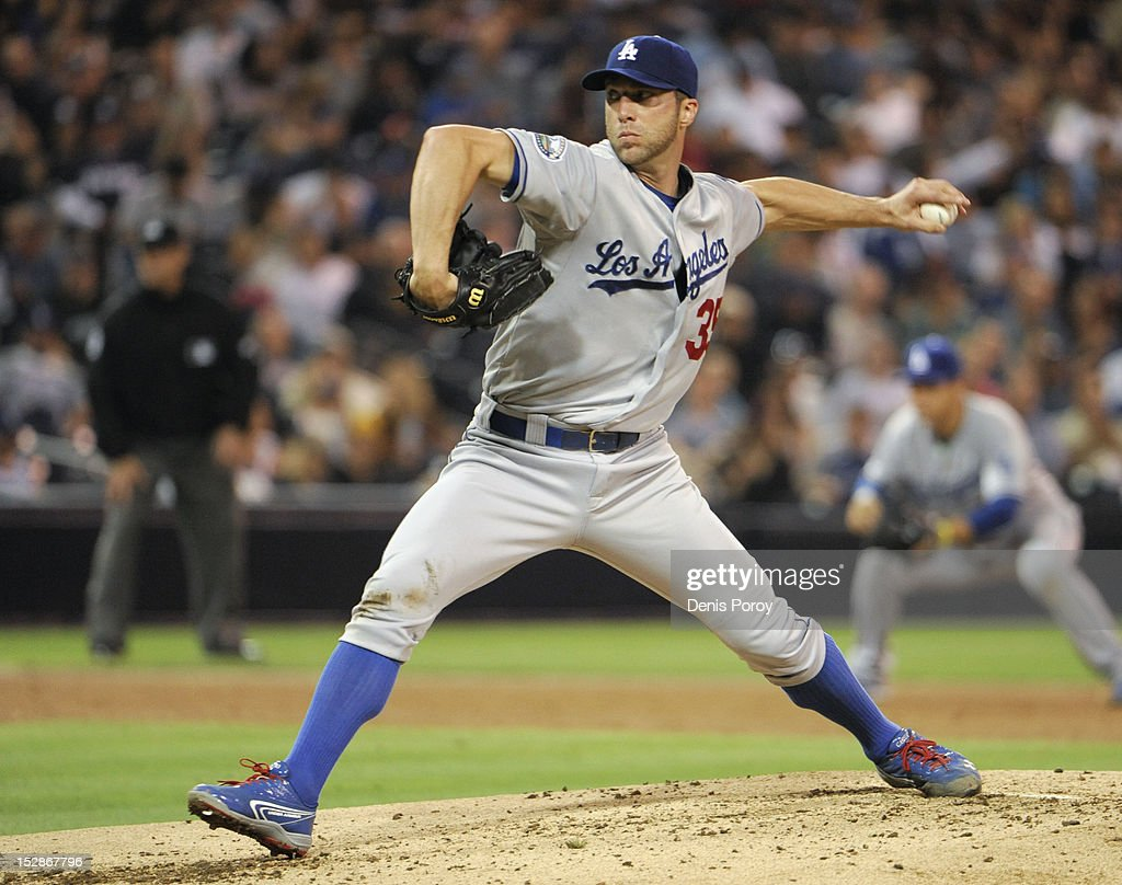 <a gi-track='captionPersonalityLinkClicked' href=/galleries/search?phrase=Chris+Capuano&family=editorial&specificpeople=228059 ng-click='$event.stopPropagation()'>Chris Capuano</a> #35 of the Los Angeles Dodgers pitches during the third inning of a baseball game against the San Diego Padres at Petco Park on September 27, 2012 in San Diego, California.