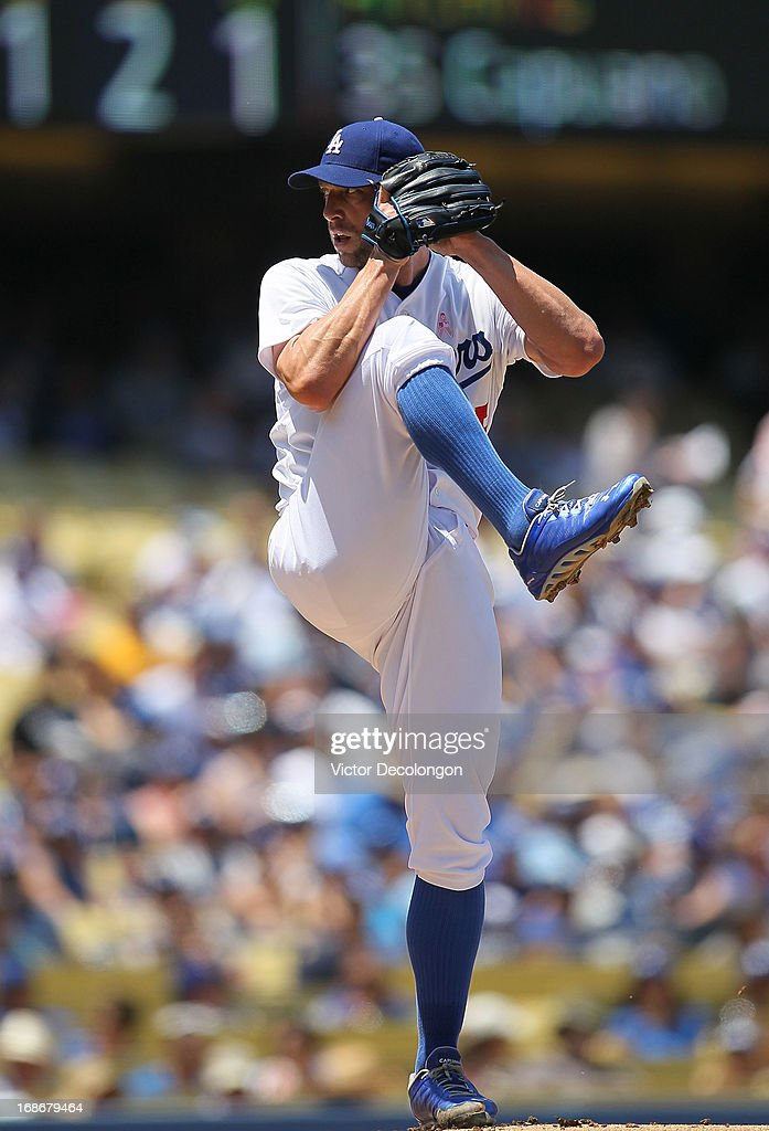 <a gi-track='captionPersonalityLinkClicked' href=/galleries/search?phrase=Chris+Capuano&family=editorial&specificpeople=228059 ng-click='$event.stopPropagation()'>Chris Capuano</a> #35 of the Los Angeles Dodgers pitches in the first inning against the Miami Marlins during the MLB game at Dodger Stadium on May 12, 2013 in Los Angeles, California. The Dodgers defeated the Marlins 5-3.