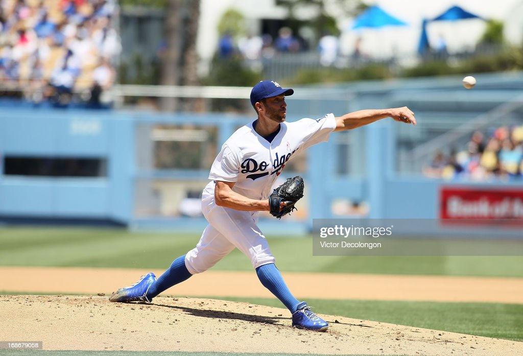 <a gi-track='captionPersonalityLinkClicked' href=/galleries/search?phrase=Chris+Capuano&family=editorial&specificpeople=228059 ng-click='$event.stopPropagation()'>Chris Capuano</a> #35 of the Los Angeles Dodgers pitches in the third inning against the Miami Marlins during the MLB game at Dodger Stadium on May 12, 2013 in Los Angeles, California. The Dodgers defeated the Marlins 5-3.