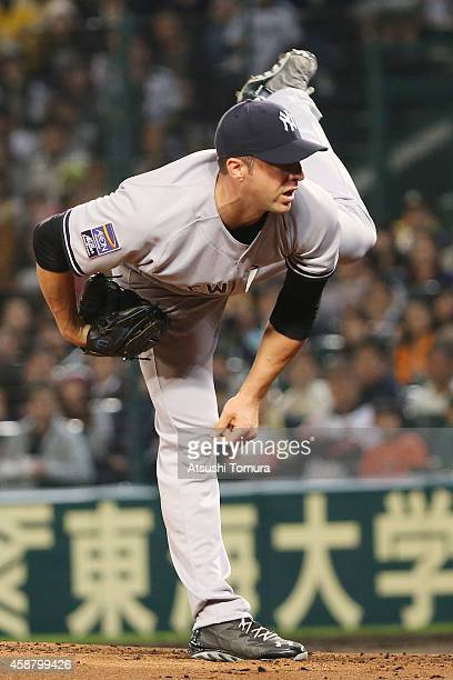 Chris Capuano of the New York Yankees in action during the friendly match between Hanshin Tigers and Yomiuri Giants at the Hanshin Koshien Stadium on...