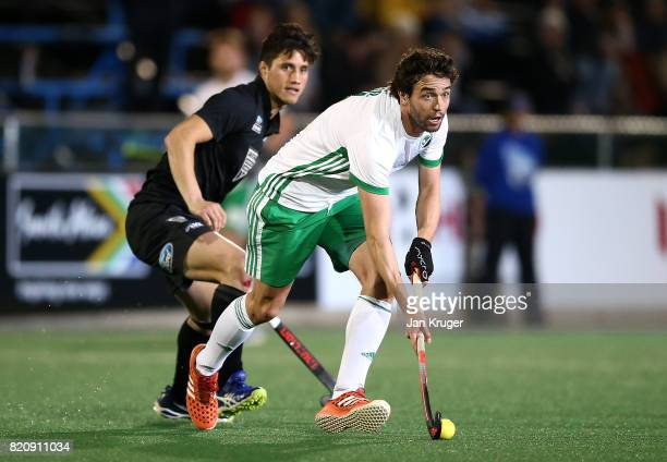 Chris Cargo of Ireland controls the ball from Leo MitaiWells of New Zealand during day 8 of the FIH Hockey World League Men's Semi Finals 5th/ 6th...