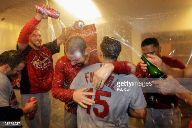 Chris Carpenter and Rafael Furcal of the St Louis Cardinals celerbate with teammates in the locker room after they won 10 against the Philadelphia...
