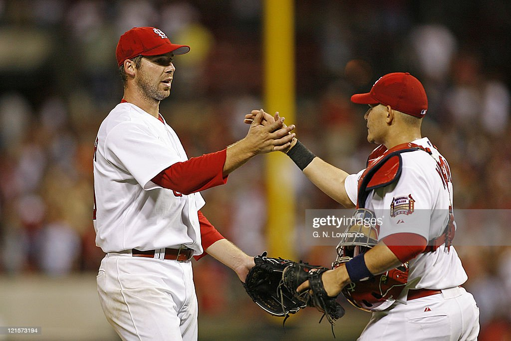 <a gi-track='captionPersonalityLinkClicked' href=/galleries/search?phrase=Chris+Carpenter+-+Baseball+Player&family=editorial&specificpeople=208139 ng-click='$event.stopPropagation()'>Chris Carpenter</a> (left) of St. Louis is congratulated by catcher <a gi-track='captionPersonalityLinkClicked' href=/galleries/search?phrase=Yadier+Molina&family=editorial&specificpeople=172002 ng-click='$event.stopPropagation()'>Yadier Molina</a> after throwing a 2-hit shutout against the Los Angeles Dodgers and St. Louis Cardinals at Busch Stadium in St. Louis, Missouri on July 14, 2006. The Cardinals won 5-0.