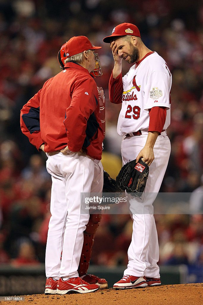 <a gi-track='captionPersonalityLinkClicked' href=/galleries/search?phrase=Chris+Carpenter+-+Baseball+Player&family=editorial&specificpeople=208139 ng-click='$event.stopPropagation()'>Chris Carpenter</a> #29 of the St. Louis Cardinals is visited on the mound by pitching coach <a gi-track='captionPersonalityLinkClicked' href=/galleries/search?phrase=Dave+Duncan&family=editorial&specificpeople=548039 ng-click='$event.stopPropagation()'>Dave Duncan</a> during Game Seven of the MLB World Series against the Texas Rangers at Busch Stadium on October 28, 2011 in St Louis, Missouri.
