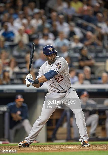 Chris Carter of the Houston Astros bats during the game against the New York Yankees at Yankee Stadium on August 19 2014 in the Bronx borough of New...