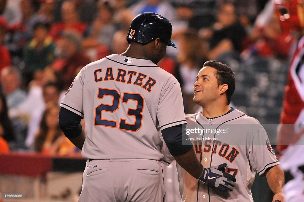 Chris Carter #23 of the Houston Astros celebrates a three run home run with <a gi-track='captionPersonalityLinkClicked' href=/galleries/search?phrase=Jose+Altuve&family=editorial&specificpeople=7934195 ng-click='$event.stopPropagation()'>Jose Altuve</a> #27 in the eighth inning during a game against the Los Angeles Angels of Anaheim at Angel Stadium of Anaheim on August 16, 2013 in Anaheim, California.