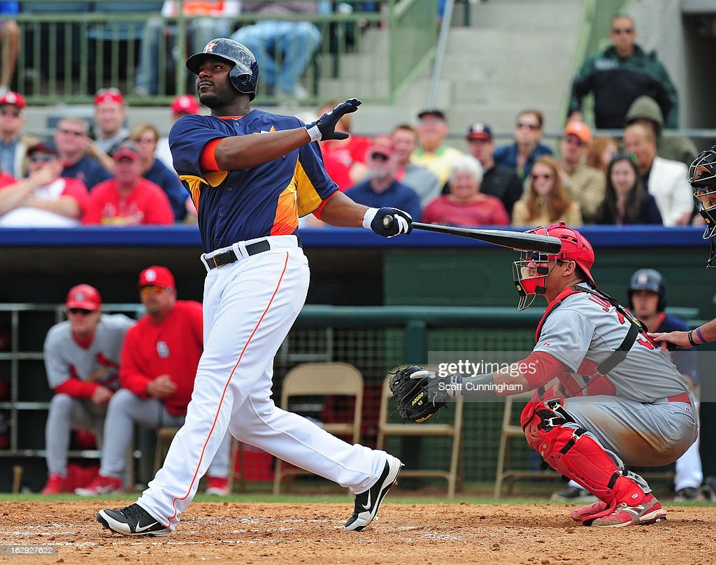 Chris Carter #13 of the Houston Astros hits a fifth inning home run against the St. Louis Cardinals during a spring training game at Osceola County Stadium on March 1, 2013 in Kissimmee, Florida.