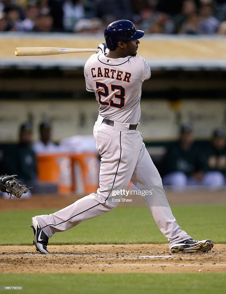 Chris Carter #23 of the Houston Astros hits a single that scored Jose Altuve #27 in the third inning of their game against the Oakland Athletics at O.co Coliseum on April 16, 2013 in Oakland, California.