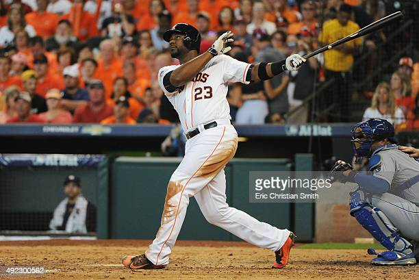 Chris Carter of the Houston Astros hits a solo home run in the seventh inning against the Kansas City Royals in game three of the American League...