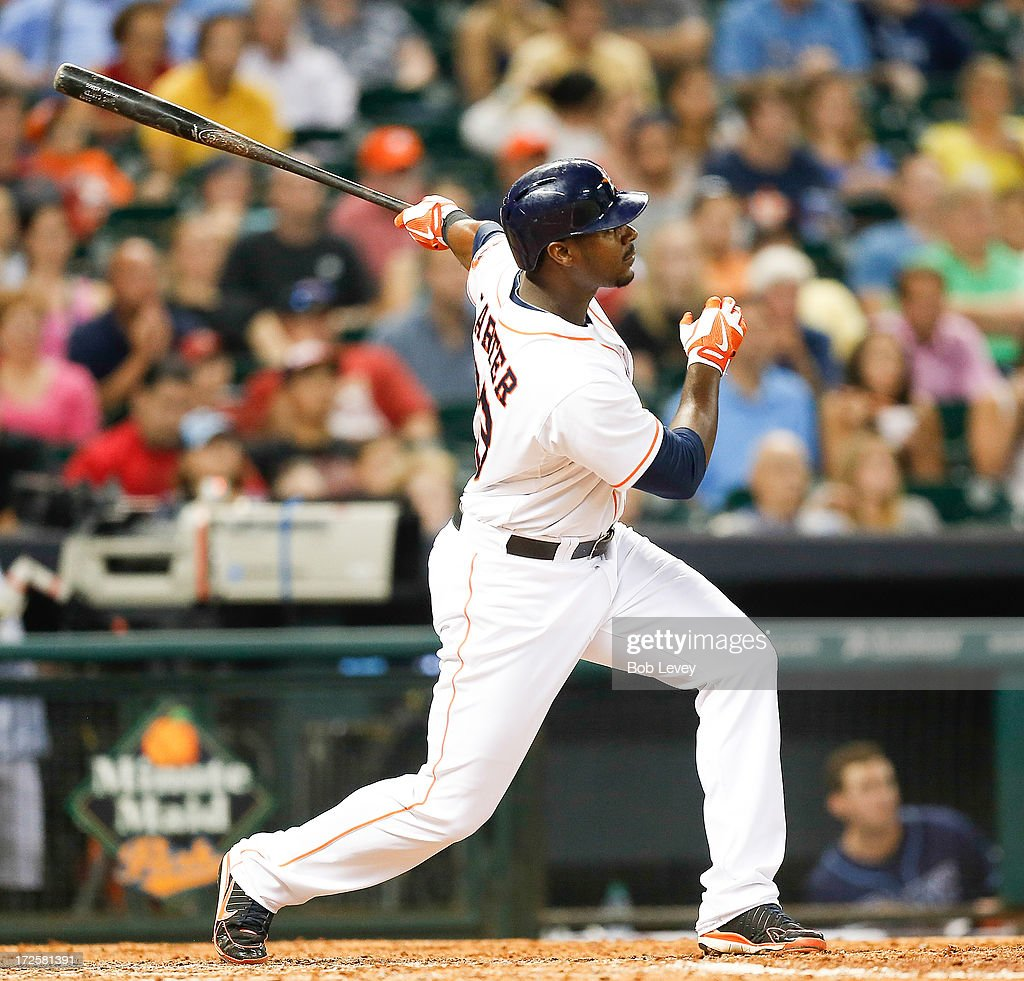 Chris Carter #23 of the Houston Astros hits a three run home run in the seventh inning against the Tampa Bay Rays at Minute Maid Park on July 3, 2013 in Houston, Texas.
