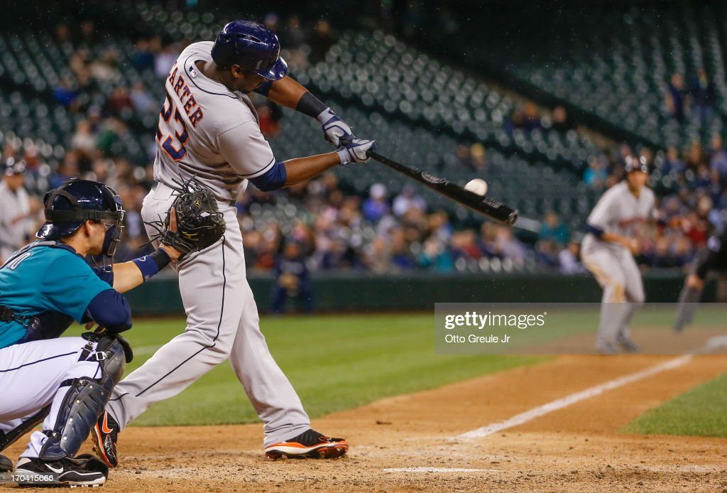 Chris Carter #23 of the Houston Astros hits a two-RBI double in the ninth inning against the Seattle Mariners at Safeco Field on June 12, 2013 in Seattle, Washington.