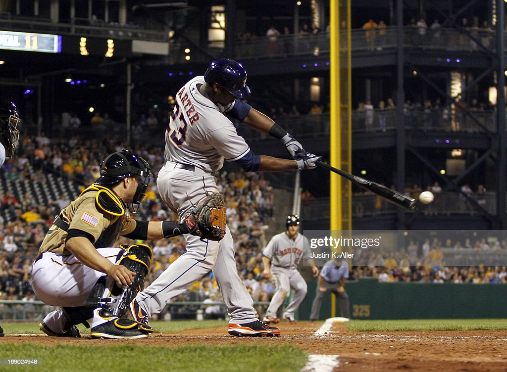 Chris Carter #23 of the Houston Astros hits an RBI single in the eighth inning making the score 2-2 against the Pittsburgh Pirates during the game on May 18, 2013 at PNC Park in Pittsburgh, Pennsylvania.