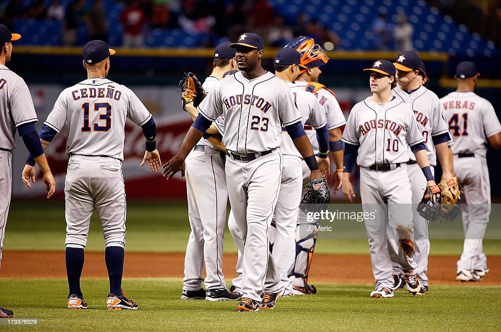 Chris Carter #23 of the Houston Astros is congratulated after a victory over the Tampa Bay Rays at Tropicana Field on July 12, 2013 in St. Petersburg, Florida.