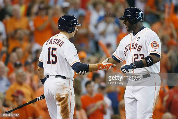Chris Carter of the Houston Astros is congratulated by Jason Castro of the Houston Astros after hitting a solo home run in the seventh inning against...