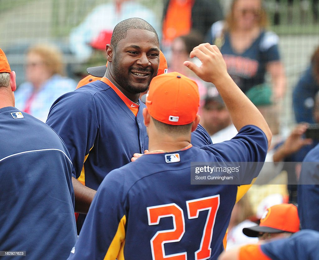 Chris Carter #13 of the Houston Astros is congratulated by <a gi-track='captionPersonalityLinkClicked' href=/galleries/search?phrase=Jose+Altuve&family=editorial&specificpeople=7934195 ng-click='$event.stopPropagation()'>Jose Altuve</a> #27 after hitting a fifth inning home run against the St. Louis Cardinals during a spring training game at Osceola County Stadium on March 1, 2013 in Kissimmee, Florida.