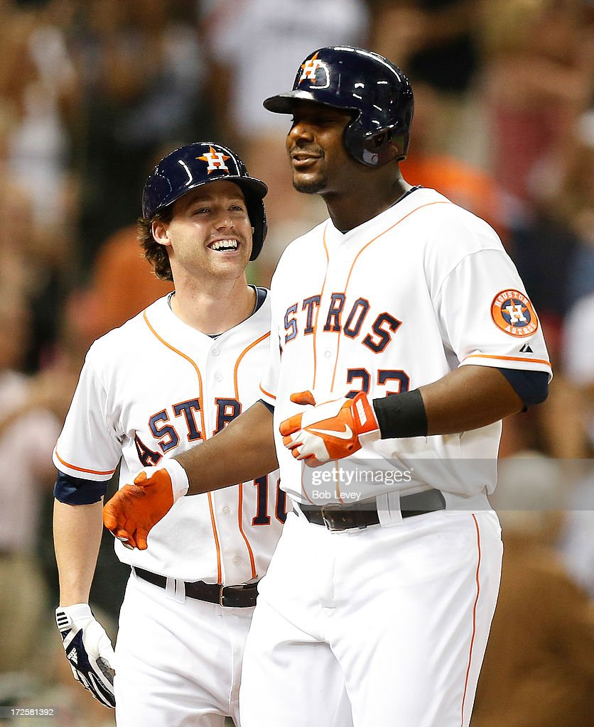 Chris Carter #23 of the Houston Astros receives congratulations from Jake Elmore #10 of the Houston Astros hits a three run home run in the seventh inning against the Tampa Bay Rays at Minute Maid Park on July 3, 2013 in Houston, Texas.