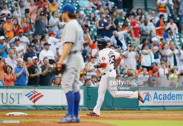 Chris Carter of the Houston Astros rounds third base after a solo home run off RA Dickey of the Toronto Blue Jays during the fifth inning of their...