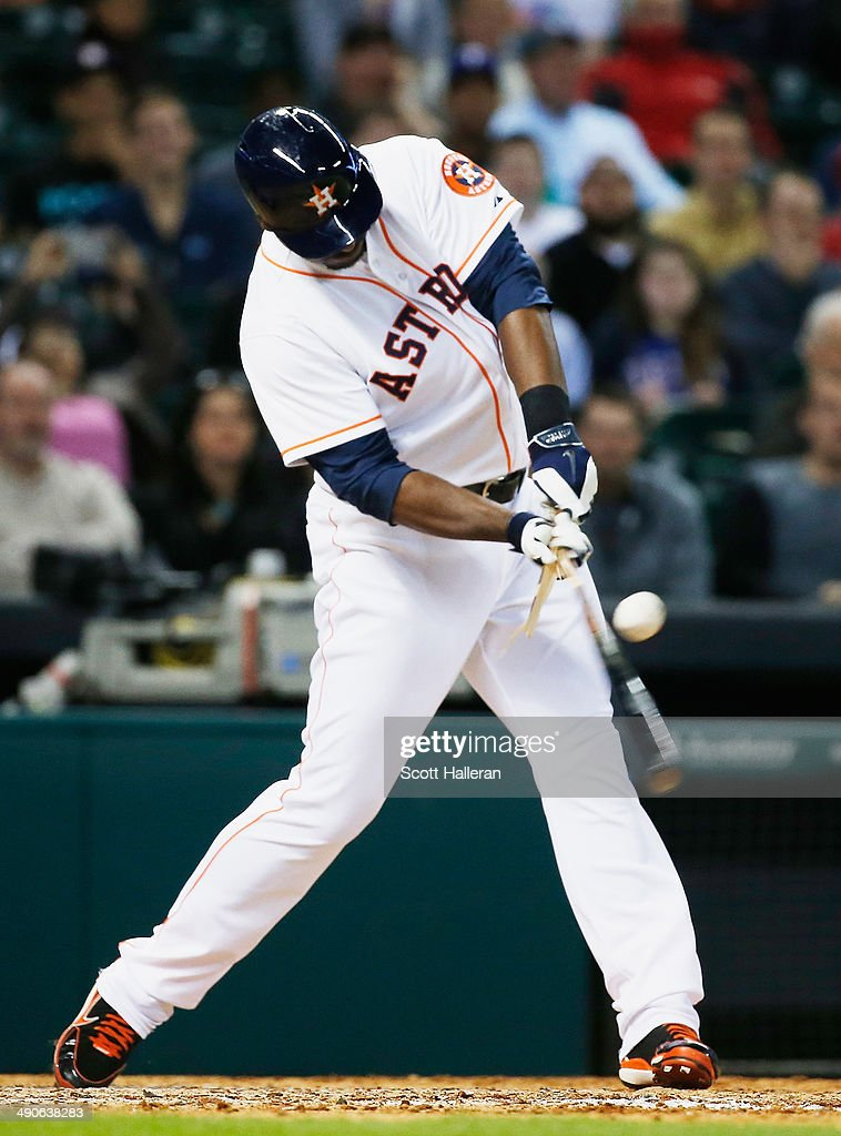 Chris Carter #23 of the Houston Astros shatters his bat with an RBI single in the sixth inning of their game against the Texas Rangers at Minute Maid Park on May 14, 2014 in Houston, Texas.