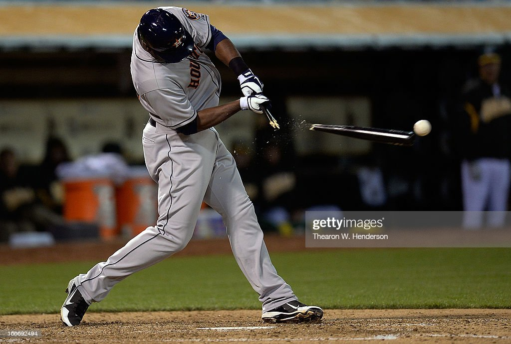 Chris Carter of the Houston Astros swings and breaks his bat against the Oakland Athletics in the six inning at O.co Coliseum on April 15, 2013 in Oakland, California. All uniformed team members are wearing jersey number 42 in honor of Jackie Robinson Day.