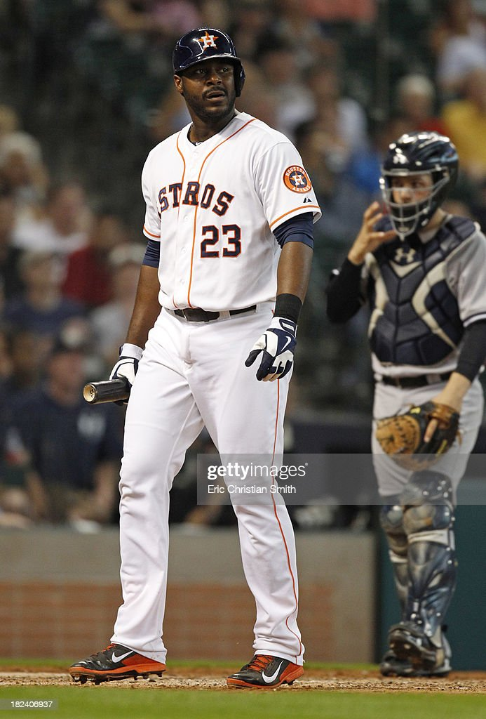 Chris Carter #23 of the Houston Astros walks back to the dugout after striking out during the ninth inning against the New York Yankees on September 29, 2013 at Minute Maid Park in Houston, TX. Carter's strikeout tied the MLB record for most strikeouts by a team set by the 2010 Arizona Diamondbacks at 1,529.