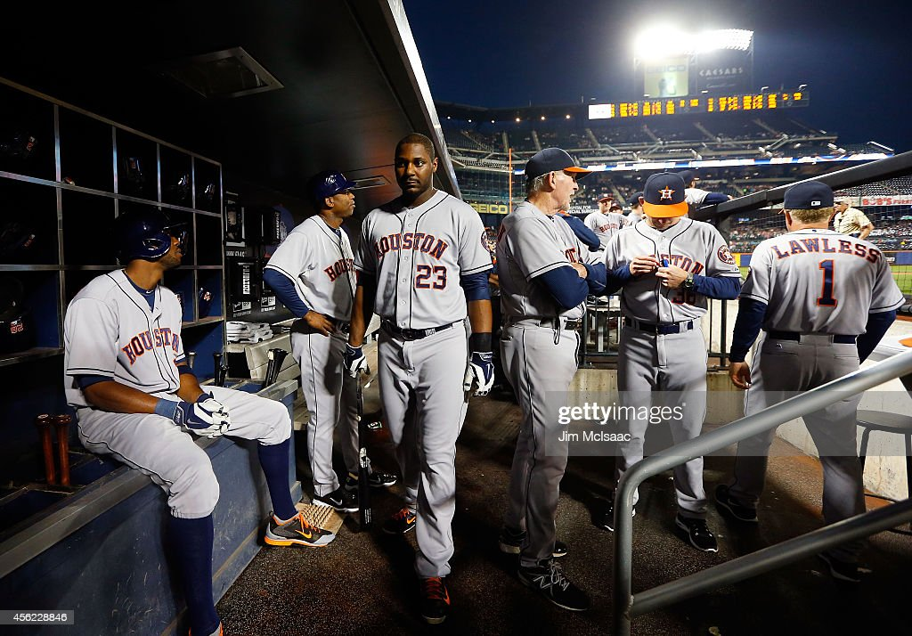 Chris Carter of the Houston Astros walks through the dugout prior to a game against the New York Mets at Citi Field on September 27 2014 in the...