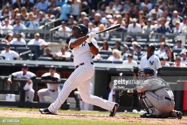Chris Carter of the New York Yankees bats against the Tampa Bay Rays during the New York Yankees home Opening game at Yankee Stadium on April 10 2017...