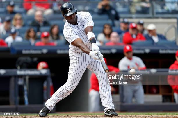 Chris Carter of the New York Yankees hits an RBI single during the sixth inning against the St Louis Cardinals at Yankee Stadium on April 15 2017 in...