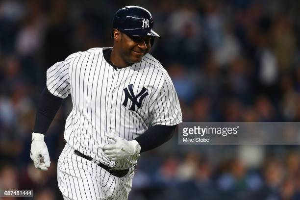 Chris Carter of the New York Yankees reacts after hitting a solohome run in the fifth inning against the Kansas City Royals at Yankee Stadium on May...