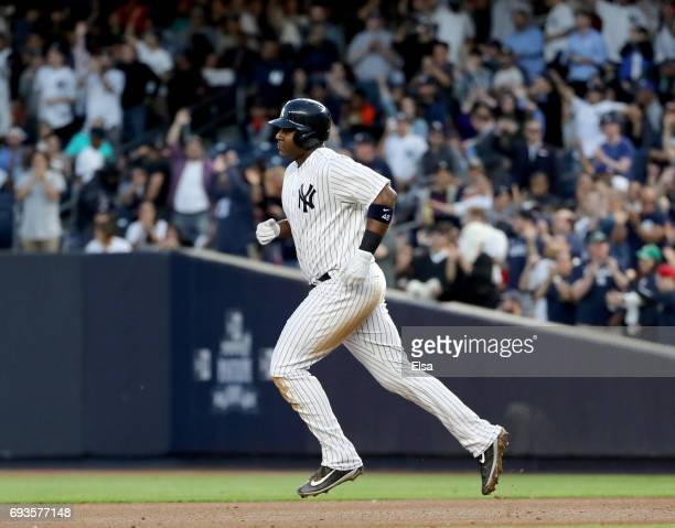Chris Carter of the New York Yankees rounds the bases after he hit a three run home run in the fourth inning against the Boston Red Sox on June 7...