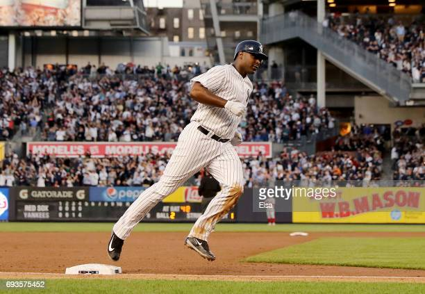 Chris Carter of the New York Yankees rounds the bases after his three run home run in the fourth inning against the Boston Red Sox on June 7 2017 at...