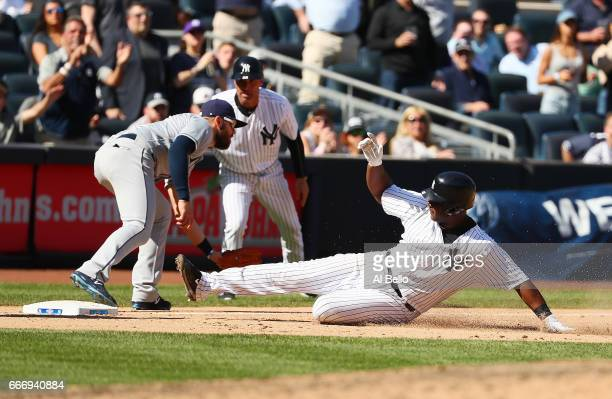 Chris Carter of the New York Yankees triples and drives in a run in the eighth inning against the Tampa Bay Rays during the New York Yankees home...