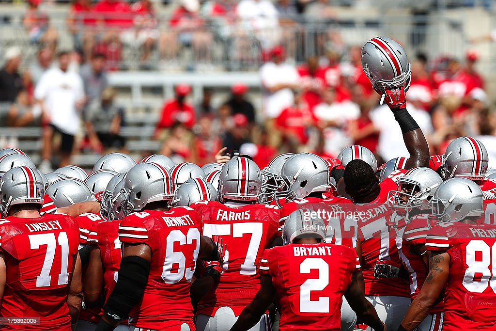 Chris Carter #72 of the Ohio State Buckeyes attempts to fire up his teammates prior to the strait of the game against the Buffalo Bulls on August 31, 2013 at Ohio Stadium in Columbus, Ohio. Ohio State defeated Buffalo 40-20.