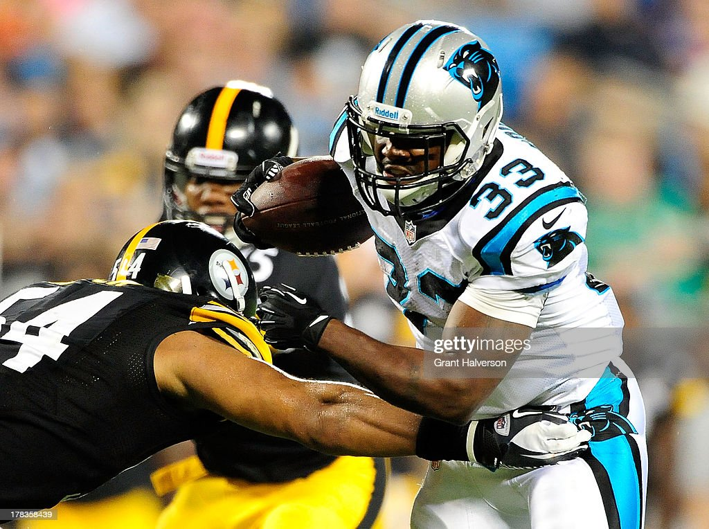 Chris Carter #54 of the Pittsburgh Steelers tackles Tauren Poole #33 of the Carolina Panthers during a preseason NFL game at Bank of America Stadium on August 29, 2013 in Charlotte, North Carolina. The Panthers won 25-10.