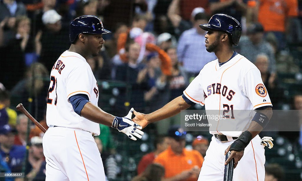 Chris Carter#23 of the Houston Astros (L) greets <a gi-track='captionPersonalityLinkClicked' href=/galleries/search?phrase=Dexter+Fowler&family=editorial&specificpeople=4949024 ng-click='$event.stopPropagation()'>Dexter Fowler</a> #21 after Fowler scored a run in the sixth inning of their game against the Texas Rangers at Minute Maid Park on May 14, 2014 in Houston, Texas.