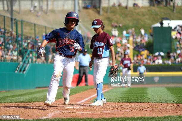 Chris Cartnick of the MidAtlantic team from New Jersey scores during Game 2 of the 2017 Little League World Series against the New England team from...