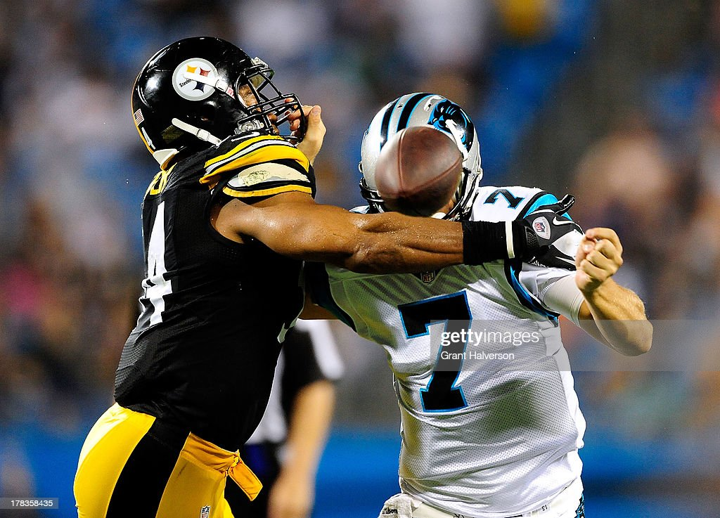 Chris Cater #54 of the Pittsburgh Steelers jars the ball loose as he hits quarterback Jimmy Clausen #7 of the Carolina Panthers during a preseason NFL game at Bank of America Stadium on August 29, 2013 in Charlotte, North Carolina. The Panthers won 25-10.