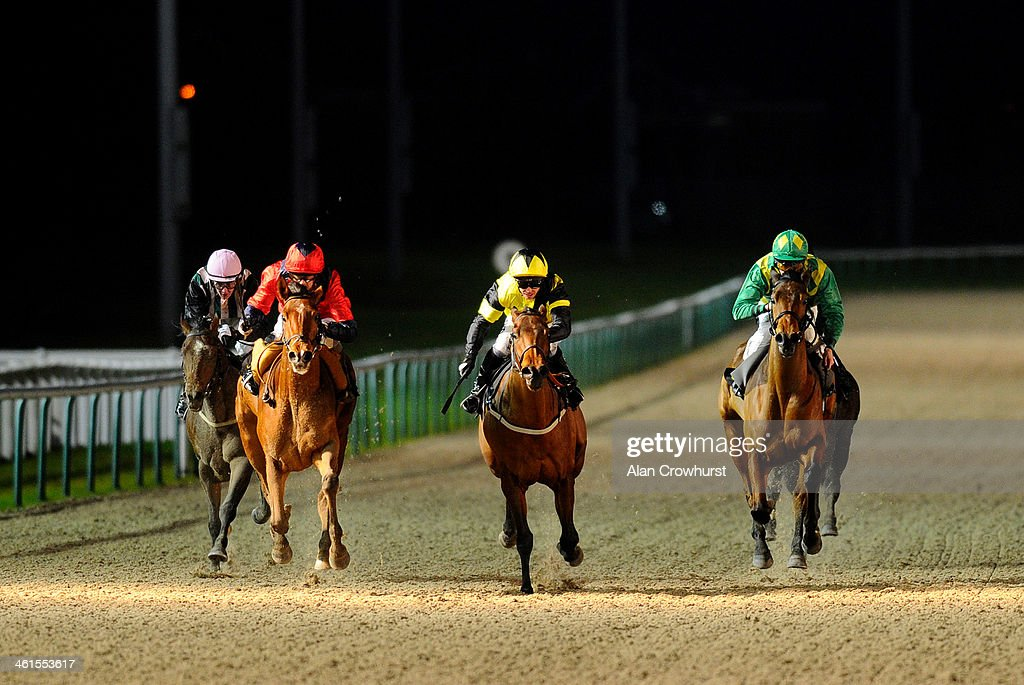 Chris Catlin riding First Experience win The 32Red Handicap Stakes at Wolverhampton racecourse on January 09 2014 in Wolverhampton England