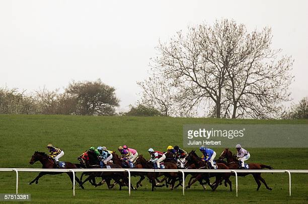 Chris Cavanagh and Danish Monarch lead the field down the back straight before landing The South West Imaging Selling Stakes Race run at Bath...