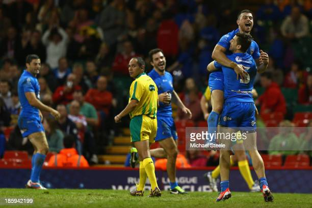 Chris Centrone of Italy celebrates scoring a try with Ben Falcone during the Rugby League World Cup Inter group match between Wales and Italy at the...
