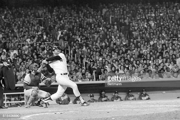 Chris Chambliss hits a home run winning the American League championship which Kansas City Royals' catcher Buck Martinez behind him