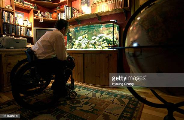 LITTLETON COLO NOVEMBER 16 2004 Chris Chappell is watching his fishtank at his home in Littleton on Monday Chris Chappell injured his spinal cord in...