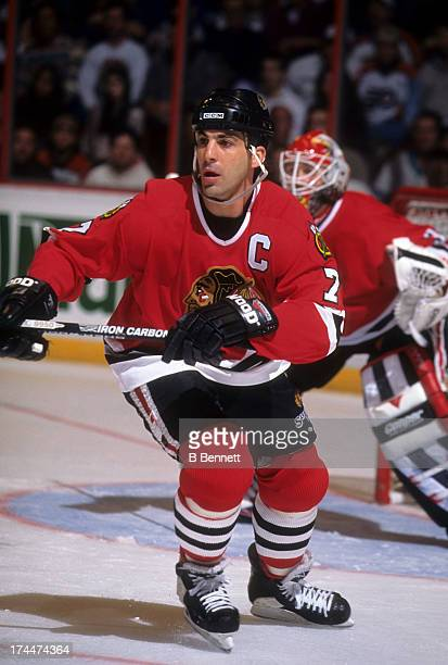 Chris Chelios of the Chicago Blackhawks looks to pass the puck during an NHL game against the Philadelphia Flyers circa 1997 at the Spectrum in...