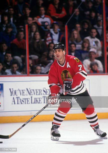 Chris Chelios of the Chicago Blackhawks looks to pass the puck during an NHL game against the Philadelphia Flyers circa 1993 at the Spectrum in...
