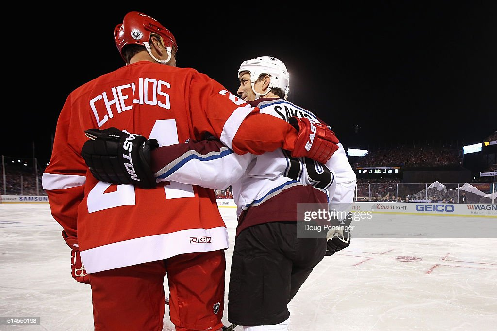 <a gi-track='captionPersonalityLinkClicked' href=/galleries/search?phrase=Chris+Chelios&family=editorial&specificpeople=203336 ng-click='$event.stopPropagation()'>Chris Chelios</a> #24 of the Detroit Red Wings and <a gi-track='captionPersonalityLinkClicked' href=/galleries/search?phrase=Joe+Sakic&family=editorial&specificpeople=202869 ng-click='$event.stopPropagation()'>Joe Sakic</a> #19 of the Colorado Avalanche skate across the ice during the 2016 Coors Light Stadium Series Alumni Game at Coors Field on February 26, 2016 in Denver, Colorado. The Avalanche defeated the Red Wings 5-2.