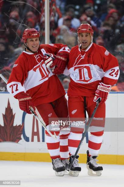Chris Chelios of the Detroit Red Wings celebrates his goal in the first period against the Toronto Maple Leafs with Paul Coffey during the 2013...
